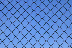 Metallic net with blue background Royalty Free Stock Photography