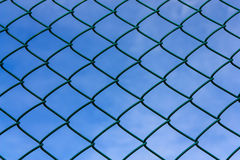 Metallic net with blue sky Stock Images