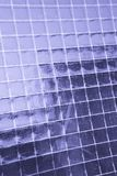 Metallic net in glass Royalty Free Stock Photography