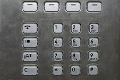Metallic number pad on a public phone Stock Photos