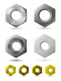 Metallic nuts. A set of  metallic nuts of four different types Royalty Free Stock Photo