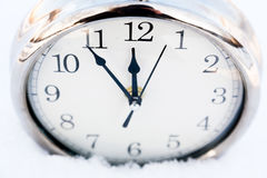 Metallic old watch in snow. Stock Photography