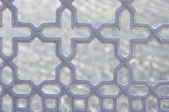 Metallic ornamental fence. Close up on cross, stars shape railing. Dark grey colour on water background. Stock Photography