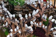 Metallic owl statue in garden Stock Photos