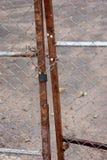 A metallic padlock and chain lock at fence door.  royalty free stock photos