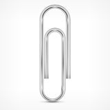 Metallic paperclip on white Stock Image