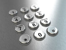 Metallic pay phone keypad. Royalty Free Stock Photos