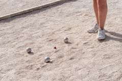 Metallic petanque balls on a fine gravel ground Stock Image