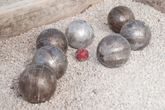 Metallic petanque balls and a small red jack Royalty Free Stock Photos