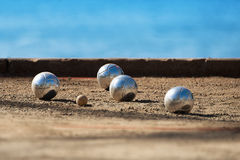 Metallic petanque four balls. And a small wood jack royalty free stock image