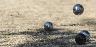 Metallic petanque three balls and a small wood jack Stock Images