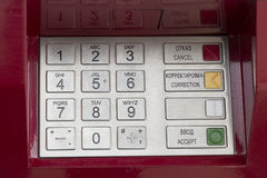 Metallic pinpad ATM on a red background royalty free stock images