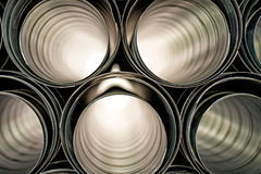 Metallic Pipes stacked in rows pattern Royalty Free Stock Photos