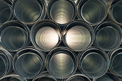 Metallic Pipes stacked in rows pattern Royalty Free Stock Image