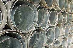 Metallic Pipes stacked in rows pattern Royalty Free Stock Photography