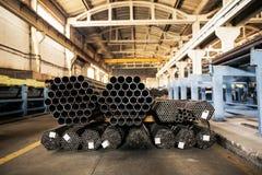 Metallic pipes on warehouse, rows of metal pipes on industrial warehouse. Industrial interior, royalty free stock photos