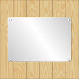 Metallic plaque. Wooden planks bacground with metallic plaque Royalty Free Stock Images