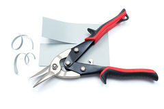 Metallic plate cut with scissors Royalty Free Stock Photo