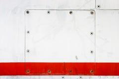 Metallic plate screwed to metallic Stock Photo