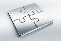 Metallic puzzle pieces Royalty Free Stock Photo