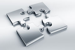 Metallic puzzle pieces Stock Photo