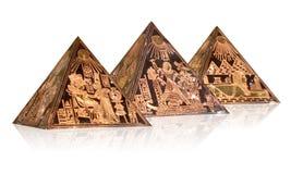 Metallic pyramids. Pyramids metallic models with Pharaoh symbols Royalty Free Stock Images