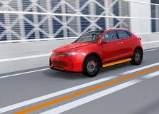 Metallic red autonomous electric SUV driving on the highway. 3D rendering image royalty free illustration
