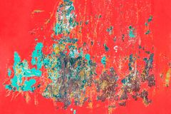 Metallic red background with peeling paint and blue spots and ru. Old red metal background with cracked, peeling paint with stains of blue paint and rust spots Royalty Free Stock Image