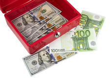 Metallic red box with money Stock Images