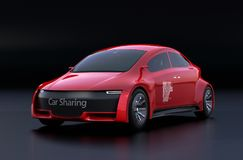 Metallic red electric car on black background Royalty Free Stock Images