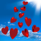 Metallic Red Hearts Falling From The Sky Stock Photos