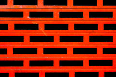 Metallic red shutters. With black holes detail Stock Photography