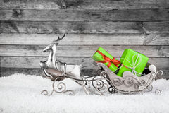 Metallic Reindeer and Sleigh with Green Gifts Royalty Free Stock Images