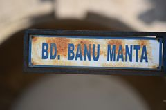 Metallic road sign, Bulevard Banu Manta, Bucharest, Romania. Closeup view over a rusty road sign in Bucharest Royalty Free Stock Image