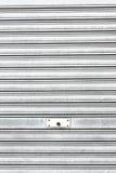 Metallic roller shutter with door lock Stock Photos