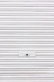Metallic roller shutter with door lock Stock Images