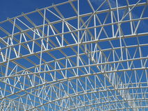 Metallic roof frame soaring into blue sky Royalty Free Stock Images