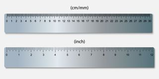 Rulers, marked in centimeters and inches. Metallic rulers, marked in centimeters, inches Stock Image