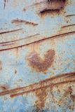 Metallic rust texture with heart shape Royalty Free Stock Photos