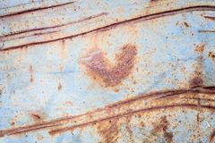 Metallic rust texture with heart shape Royalty Free Stock Photo