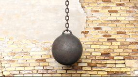 Metallic rusty wrecking ball on chain. With old brick wall background 3D rendering Royalty Free Stock Photo