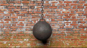 Metallic rusty wrecking ball on chain. With old brick wall background 3D rendering Stock Photos