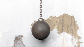 Metallic rusty wrecking ball on chain. With old wall. 3D rendering Stock Photo