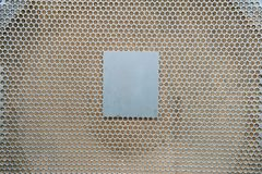 Metallic sheet plate with holes. Close up metallic sheet plate with holes Stock Image