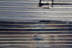 Metallic sheets. Metallic rusted lines, metallic sheets texture background, close up of some welded aluminum sheets used as part of a roof royalty free stock photo