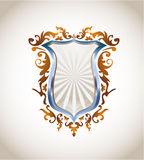 Metallic shield with ornament Stock Images