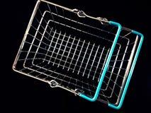 Metallic shopping basket. Isolated in black background Royalty Free Stock Photo