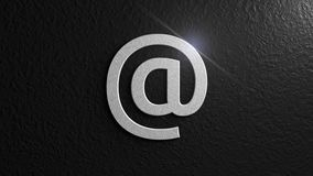 Metallic At sign with flare on black background. Email. Graphic illustration. 3d rendering. Digital art of  `At` sign Royalty Free Stock Photos