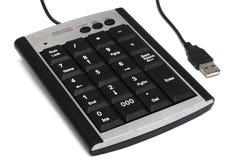 A metallic silver black multiple function USB wired numeric keypad. A photo taken on a metallic silver black colored multiple function USB wired numeric keypad stock photos