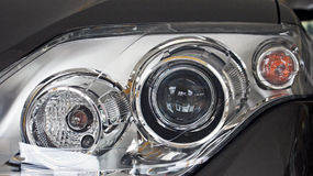 Metallic silver car headlight detail close up Royalty Free Stock Image